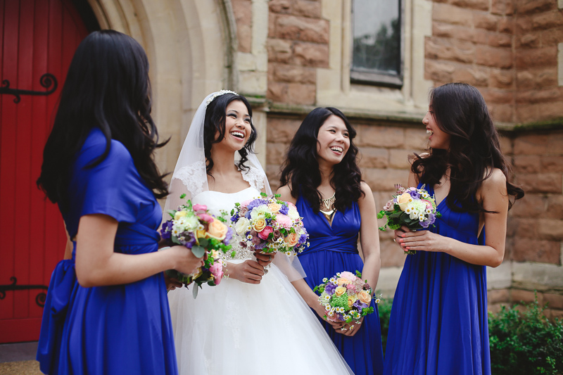 bride with bridesmaids at St Pauls in London by Love oh Love photography
