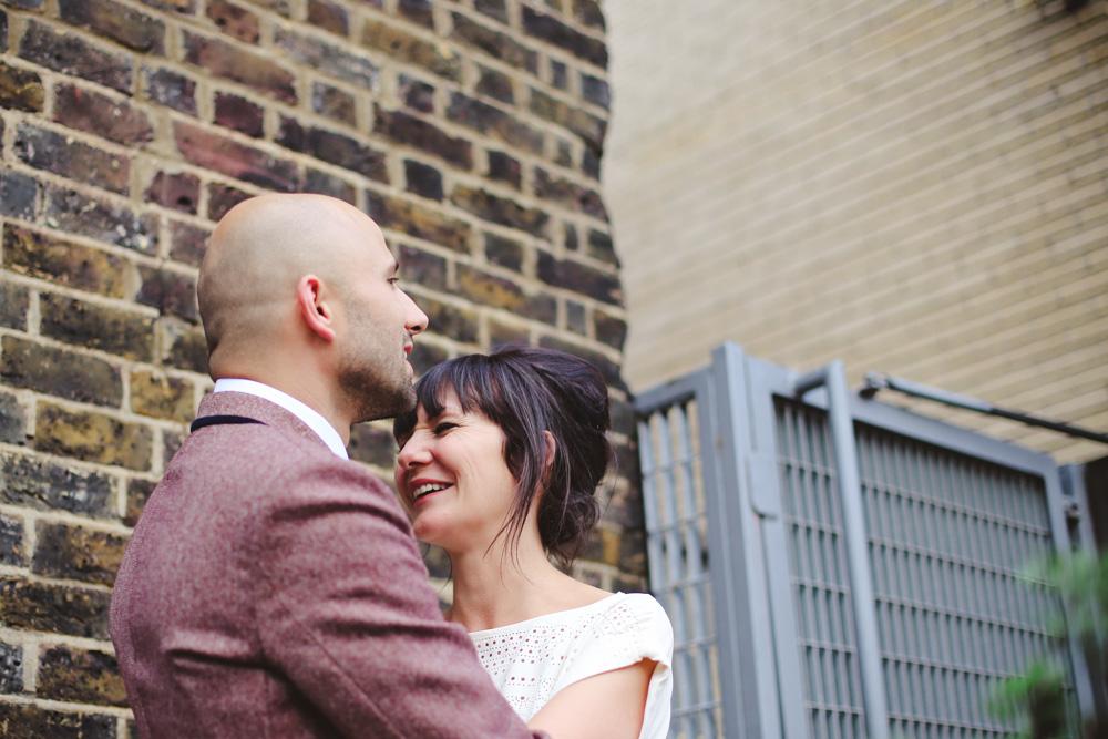 bride and groom laughing by love oh love photography