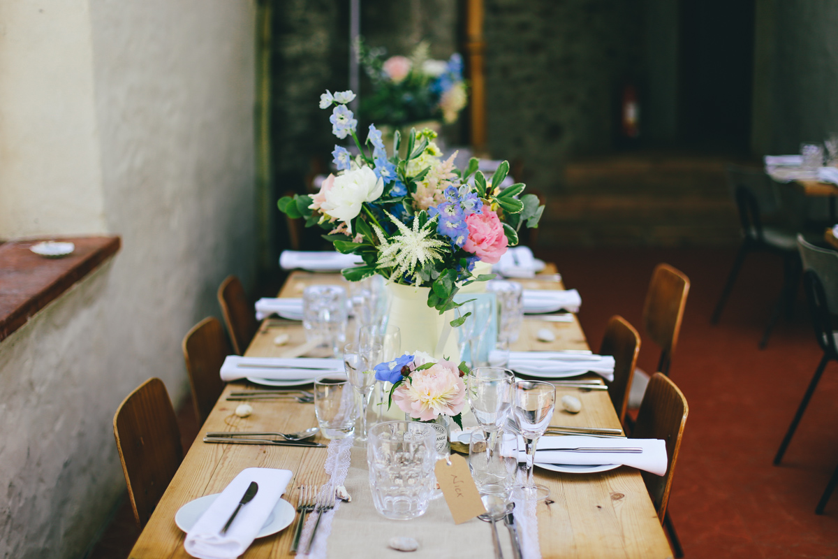 Table decorations and flowers at Prussia Cove, Cornwall wedding by Love Oh Love Photography