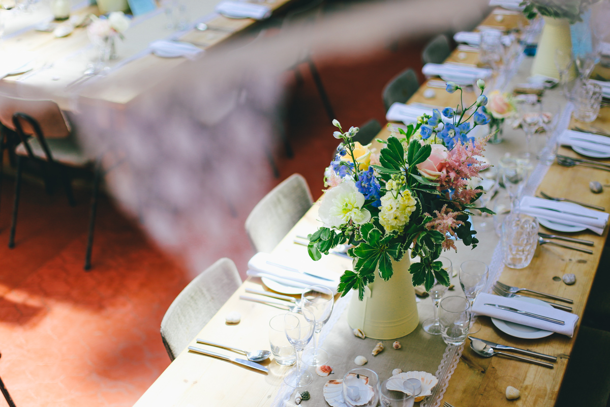 Table decorations at Prussia Cove, Cornwall Wedding by Love Oh Love Photography