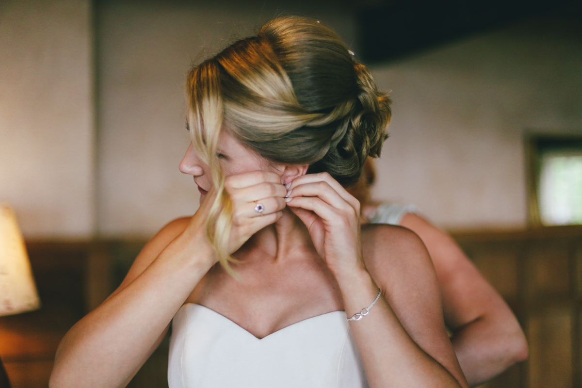 Cameras and bride at Prussia Cove, Cornwall wedding by Love Oh Love Photography